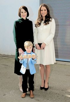 """""""The Duchess of Cambridge is presented with a train for Prince George by actor Oliver Barker and actress Michelle Dockery ."""""""
