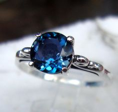 London Blue Topaz 2 ct ring in sterling silver - custom size Fair Trade, earth friendly - Spirituality - December birthstone -Engagement by ApacheMoon on Etsy https://www.etsy.com/listing/114757889/london-blue-topaz-2-ct-ring-in-sterling