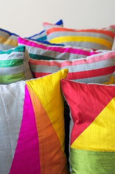 Love these happy pillows: Multicolored silk pieced pillows.
