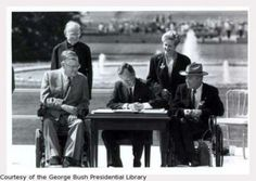 Photo of the ceremonial signing of the Americans with Disabilities Act