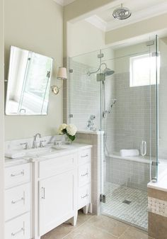 Beautiful bathroom features walls painted tan lined with a footed washstand topped with white marble and a rectangular pivot mirror illuminated by Vendome Single Sconces alongside a taupe tiled floor.