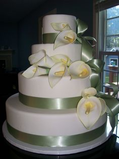 - Giant Gum Paste Calla Lillies (hand painted) on 4 tiers of fondant with satin ribbon detail.