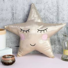 This star shaped cushion by Sass & Belle will give your home a cutesy edge.This cute star shaped mini cushion is made from a pale gold metallic material with an adorable stitched face design with circular pink cheeks. We are happy to announce that we have won the not on the high street award for best customer services for 2014. With free UK delivery on everything, and no minimum spending limit.viscosewidth 32cm x depth 7cm