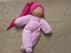 Waldorf inspired cuddle doll with a sleeping bag