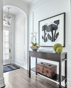 Neutral Contemporary Foyer with Antique Chest | LuxeSource | Luxe Magazine - The Luxury Home Redefined