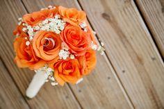 Orange with baby breath bouquet