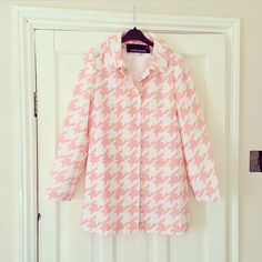 Pink and white houndstooth coat