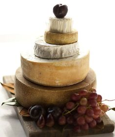 Now here's a first: a wedding cake made completely out of – you guessed it – different flavors of cheese!  This cheese wedding cake is perfect for the couple who prefers a delightful pairing of wine + cheese in lieu of the traditional cake + coffee (or tea).  Pair with your favorite bottles of wine at reception tables for an impromptu wine tasting in your honor.