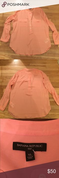 NWT! Beautiful Banana Republic Silk Shirt! New! Gorgeous peach/light coral color. 100% silk. It is see through so will need to wear a cami underneath. Buttons go half-way down shirt. Size: XL Banana Republic Tops Blouses