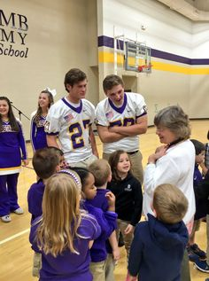 Members of the cheerleading and football teams visit the elementary school for chapel.