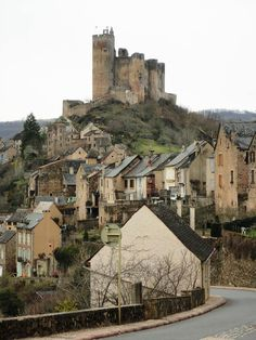 Najac~ is a village set along a ridge in southern France above a bend in the Aveyron River More