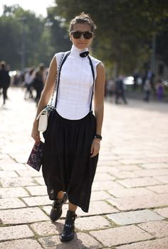 Street Fashion Top: White Sleeveless COMME DES GARCONS Shirt Skirt: Black COMME DES GARCONS Suspender Skirt Bag: White/Black CHANEL Bag Shoes: Black BALENCIAGA Boots Photo By: Phil Oh