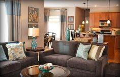 Blue and taupe greatroom. Love the glass lamps!