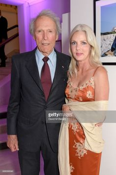 Clint Eastwood (L) and Christina Sandera attend the Vanity Fair and Chopard Party celebrating the Cannes Film Festival at Hotel du Cap-Eden-Roc on May 20, 2017 in Cap d'Antibes, France.