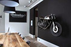 Motorcycle wall. matte black wall. wood.