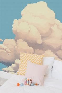 Big, fluffy and fairy tale like clouds float along in this beautiful wallpaper mural. It's an absolute delight for kid's bedrooms, nurseries and playrooms. The neutral colour palette also makes it ideal for either boy's or girl's rooms.