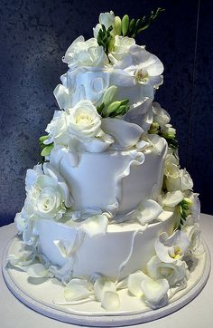3-tiered gorgeous wedding cake with fresh white flowers & soft details
