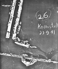 Arial photograph of the Soviet Gangut class dreadnaught Marat leaking oil after her forward section was hit by two 1000 kg German bombs at her moorings in Kronstadt, September 23, 1941. Her rear section would be re-floated and used as a floating battery during the Seige of Leningrad.