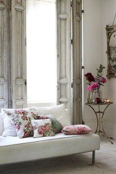 White sofa, floral pillows
