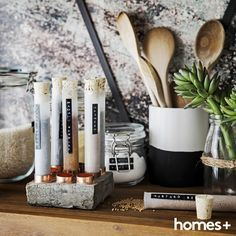 Create a #statement in your #kitchen with this #DIY #modern #style #concrete #spice #rack. As featured in the June 2015 issue of homes+. #test #tubes #storage #shelves #spices #cooking #house #home #interior #decor #design #jar #wooden #spoons #canister #wallpaper #cement #homesplusmag