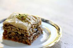 Baklava pastry recipe, layers of phyllo dough filled with honey, walnuts and pistachios.