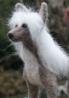 Needle felted dog sculptures