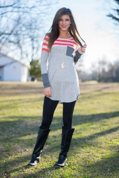 One of these days you're going to wake up late (let's face it, that late-night Downton Abbey binge may not have been the best thing before a busy day) and need something that's easy, stylish and super comfy! This super soft tunic has pops of beautiful coral in precious stripes that look amazing against the double shades of gray that makes it perfect for a rushed morning. ;) <br /> <br />Coral, gray, beige, dark gray. <br />Bra-friendly! Material has generous amount of stretch. Pocket. <br...