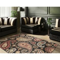 Add a bold splash of color to any room with this black decorative rug made by Infinity. Constructed of durable synthetic fibers, this rug will protect your floors, and its red and beige accent colors will complement almost any decor.
