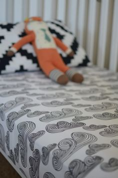 fitted crib sheet in charcoal clouds from candy kirby designs