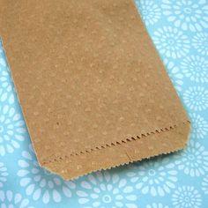 20 Kraft Paper Bags Embossed Polka Dots 3 1/4 x 5 1/4 inches. $6.50, via Etsy.