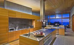 Spacious kitchen with twin islands and stainless steel countertops