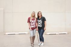 two cuties in our #TAILGATING tee's