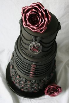 Pink and black wedding cake. I love this cake. Too much for a renewal, but still awesome