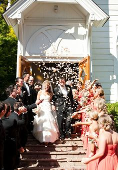 Tossing rose petals as the bride and groom exit the church.