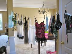 Once all the lingerie is opened, hang it up and use as a picture backdrop! Genius!
