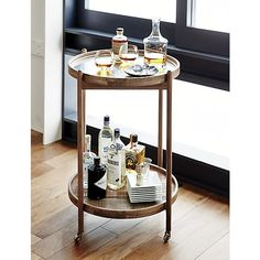 This round bar cart could be easy to make. Buy matching trays, perhaps use copper fittings to connect everything.