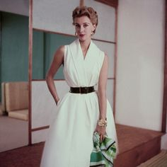 June 1952,  Take just a bit of volume out of the skirt and I would live in a dress like this in the summer.