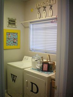 """love the letters on the washer and dryer and the tension rod for hangers...is it sad that a laundry room makeover is under """"stuff I dream about""""?  lol"""