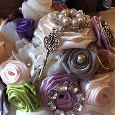 Vintage brooch bouquet.. all hand turned hand rolled roses.  All ribbon came from rolls.  Time consuming but worth it!!!