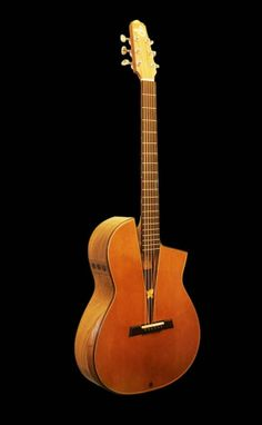 SmoothTalker Guitars nylon acoustic - something of a departure from Mervyns usual builds - 2 of 3 http://www.smoothtalkerguitars.com/