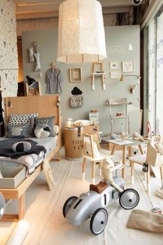 Creative boy's room with a lot going on. The mellow grey and natural color palette keeps it from looking too chaotic.