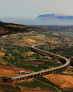 The highway viaduct seen from the temple of Segesta in Sicily, Italy (by Robyn Hooz).
