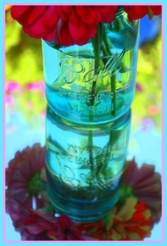 Mason Jar with Red Flower over a simple mirror