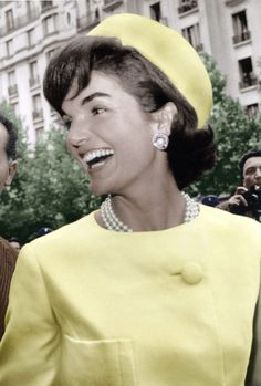 Jacqueline Kennedy during her official visit to Paris, on May 1961. She was wearing Alaskine (wool and silk) created by Oleg Cassini and pill-box hat created by Roy Halston Frowick