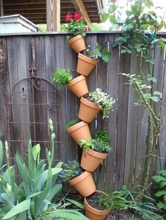 Apple garden needs this! How To: Create a DIY Vertical Garden Step-by-step instructions on how to create your own personalized vertical garden. Diy Herb Garden, Garden Steps, Garden Pots, Apple Garden, Easy Garden, Vertical Planter, Vertical Garden Diy, Stacked Flower Pots, Vertikal Garden