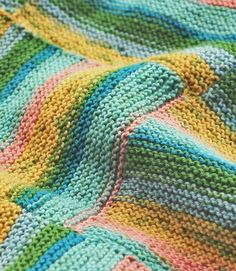 Striped Afghan in garter stitch, pieced together--Berroco® Free Pattern | Vexillo
