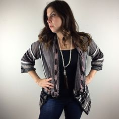 """[Missoni] Sparkle Knit Draped Front Cardigan Classic Missoni knit piece. Hard to capture in photos, but there is a metallic thread woven throughout giving this piece shimmer. 3/4 sleeve. Drape front. Drawstring woven through collar.   Color: Black, Purple, Gray, White Fabric: Viscose, Cotton, Nylon Size: US 6 Bust: approximately 20"""" Length: 21""""-31"""" Condition: EUC. No flaws.  No Trades! No PayPal! Missoni Sweaters Cardigans"""