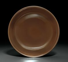 A café-au-lait-glazed dish, Qianlong six-character seal mark in underglaze blue and of the period (1736-1795)