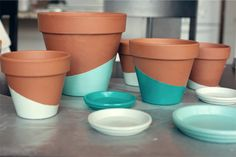 DIY color block pots from Wit and Whistle. Use wide rubber band to make the angle--use primer, acrylic paint, and shellac. Love the turquoise.