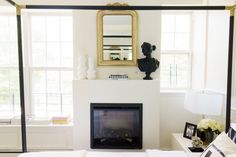 A canopy bed that looks straight through to a fireplace. The wall paint color is Timeless by Clare.